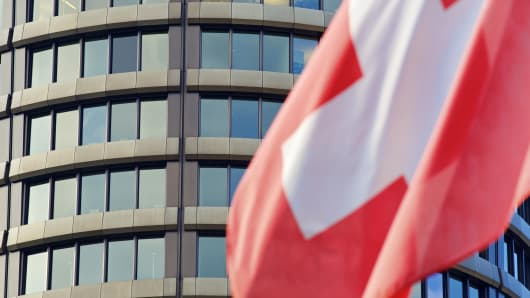 The national flag of Switzerland flies outside the headquarters of the Bank for International Settlements (BIS) in Basel, Switzerland.