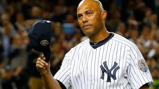 Mariano Rivera salutes fans as he leaves a game in the ninth inning at Yankee Stadium on Sept. 26.