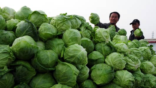 A man sells cabbages at a market in Linyi, China.