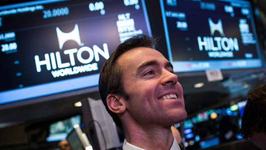 Tyler Henritze, senior managing director of real estate for Blackstone, attends the initial price offering (IPO) of Hilton Worldwide (HLT) on the floor of the New York Stock Exchange shortly after the opening bell on December 12, 2013 in New York City.