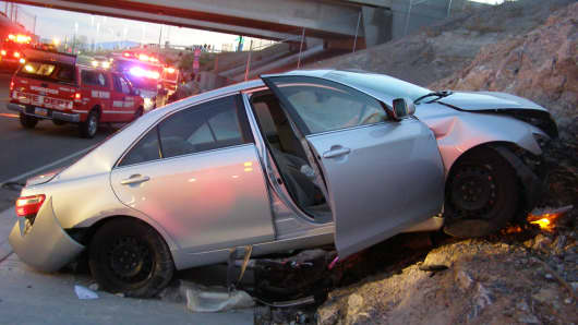 In this Nov. 5, 2010 file photo released by the Utah Highway Patrol, a Toyota Camry is shown after it crashed as it exited Interstate 80 in Wendover, Utah.