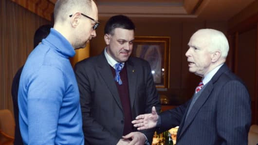 Senator John McCain (R) speaks to leaders of Ukrainian opposition Arseniy Yatsenyuk (L) from Batkivshchyna Party, and Andriy Tyagnybok (C) from Svoboda party