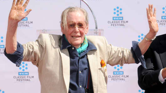 Peter O'Toole poses as his hand and footprints are enshrined in concrete at the Grauman's Chinese Theatre on April 30, 2011 in Hollywood, California.