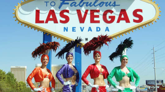 Showgirls at famous Las Vegas welcome sign