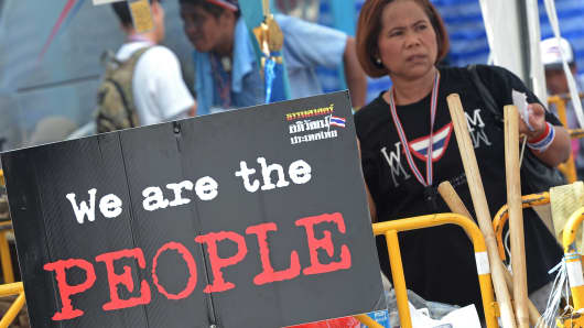 Thai anti government protesters attend a rally at the Democracy monument in Bangkok on December 15, 2013.