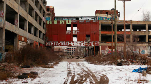 Graffiti is painted on the walls of the abandoned Packard Automotive Plant December 13, 2013 in Detroit, Michigan.
