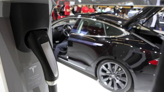 An electric charging plug for a Tesla automobile