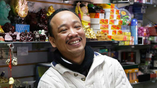 Jenny's gift shop owner Thuy Nguyen smiles at his shop Wednesday, Dec. 18, 2013, in San Jose, Calif.