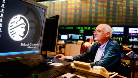 A trader works on the floor of the Buenos Aires Stock Exchange.
