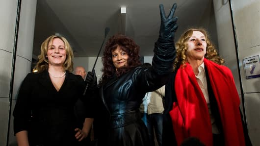 Terri-Jean Bedford, center, makes a victory sign during a press conference in Toronto on Monday, March 26, 2012 with Nikki Thomas, left, and Valerie Scott, right, after the Ontario's Court of Appeal struck down a ban on brothels, saying a ban on brothels puts prostitutes at risk and is unconstitutional.