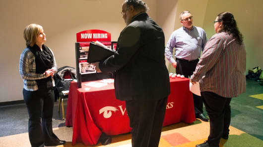 Job seekers meet with recruiters at the Columbus Career Fair in Columbus, Ohio.