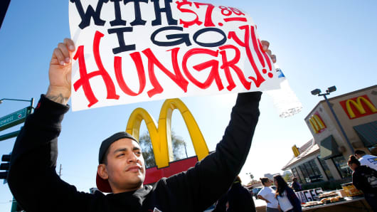 Protesters at a rally against low wages for fast-food workers, in front of a McDonald's, Dec. 5, 2013, in Phoenix.
