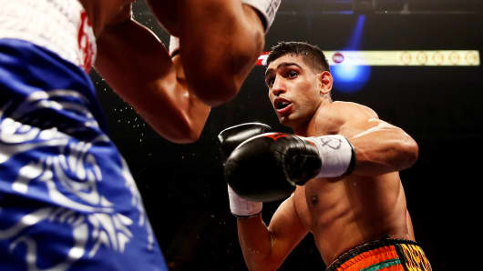 Amir Khan, right, in action against Julio Diaz at Motorpoint Arena on April 27, 2013 in Sheffield, England.