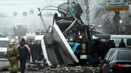 Russian firefighters and security personnel inspect a destroyed trolleybus in Volgograd on Monday.