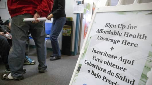 An affordable health coverage sign stands a health insurance education and enrollment event in Silver Spring, Md.