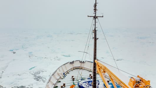 This image taken by passenger Andrew Peacock of www.footloosefotography.com on December 29, 2013 shows a thin fresh coat of snow on the trapped ship MV Akademik Shokalskiy as it waits to be rescued.