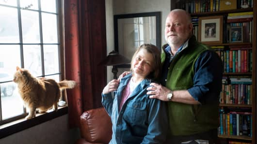 Vera Volk and her husband Eric Vaughn pose for a portrait at their home in Lynn, Mass., Tuesday, Dec. 31, 2013.