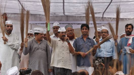 Arvind Kejriwal and other leaders of the Aam Aadmi Party. The party's election symbol is the broom.