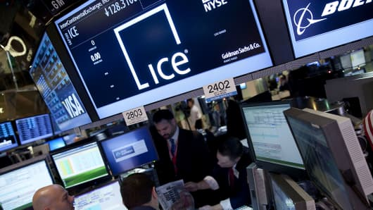 Traders work at the InterContinentalExchange Inc. (ICE) booth on the floor of the New York Stock Exchange (NYSE)
