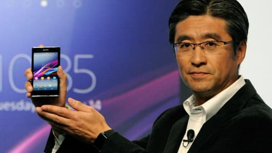 Sony's Kunimasa Suzuki displays a Sony Xperia Z1s phone during a Sony press event at the Las Vegas Convention Center for the 2014 International CES on January 6, 2014 in Las Vegas.