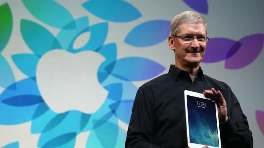 Apple CEO Tim Cook holds the new iPad Air during an Apple announcement at the Yerba Buena Center for the Arts on October 22, 2013 in San Francisco.