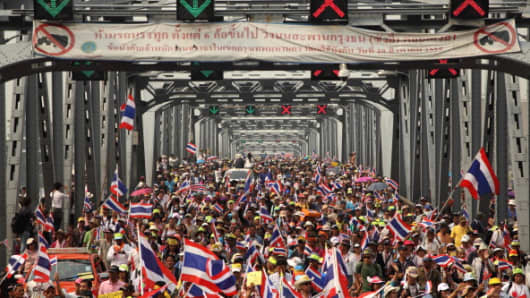 "Anti-government protesters during a march on Krung Thon Bridge in Bangkok on Sunday, January 7, 2014, in a march to drum up support for a campaign to ""shut down"" the capital on January 13."