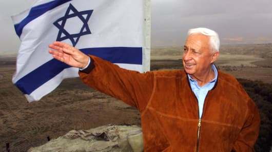 Israeli right-wing opposition leader Ariel Sharon gestures during a visit to an army lookout in Tovlan in the Jordan valley 03 January 2001.