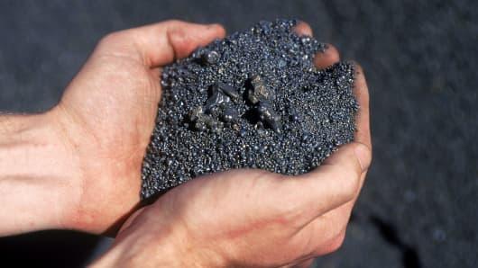 Nickel matte in workers cupped hands