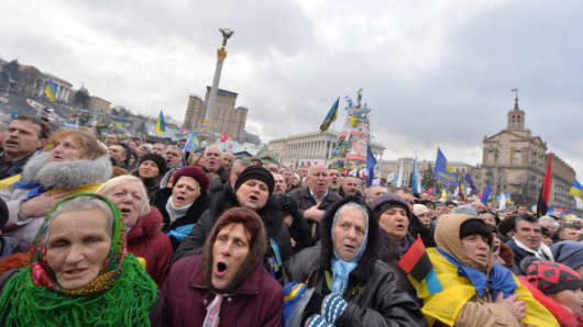 Protesters sing the national anthem during mass rally of the pro-Western Ukrainian opposition on Independence Square in Kiev.