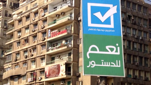 "Banner in downtown Cairo asking voters to say ""YES"" in the referendum."