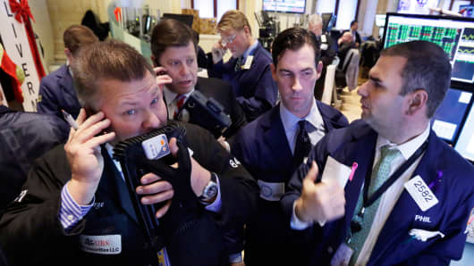 Traders gather at a post on the floor of the New York Stock Exchange Tuesday, Jan. 14, 2014.