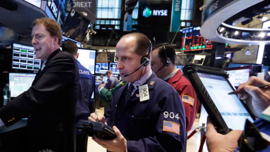 Specialist James Maher, left, works with traders at the post that handles NuSkin on the floor of the New York Stock Exchange, Thursday, Jan. 16, 2014.