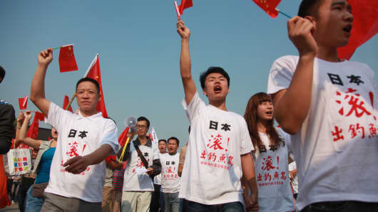Chinese demonstrators wearing anti-Japan t-shirts march with Chinese national flags during a protest against Japan's 'nationalizing' of Diaoyu Islands, also known as Senkaku in Japan, in Hengyang, central China's Hunan province.