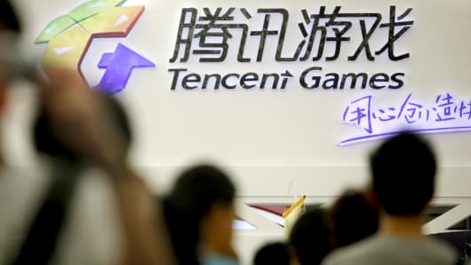 Visitors walk past a Tencent Holdings Ltd. game booth at the ChinaJoy Expo, also known as the China Digital Entertainment Expo and Conference, in Shanghai, China.