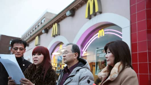 Young Jin Kim of the Korean American Business Council of New York, Christine Colligan, Stephen Kim and Mi Shim of the Korean Parents Association of New York speak to reporters outside a McDonald's in New York, Jan. 16, 2014.