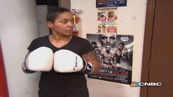 Exec leaves her publishing job -- for the boxing ring