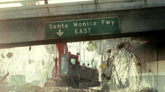 A bulldozer tears down a section of the Santa Monica Freeway, Jan. 19, 1994, that collapsed during the Northridge earthquake.