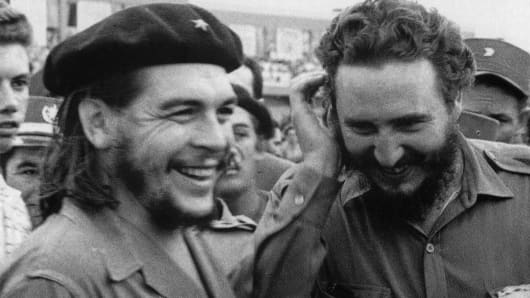 Photo taken in the 60's of then Cuban Prime Minister Fidel Castro(R) during a meeting next to Argentine guerrilla leader Ernesto Che Guevara.