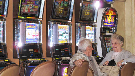In this November 2013 photo, an elderly couple plays slot machines at the Tropicana Casino and Resort in Atlantic City, N.J.