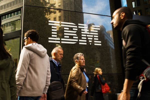 Pedestrians walk past IBM's building in New York.