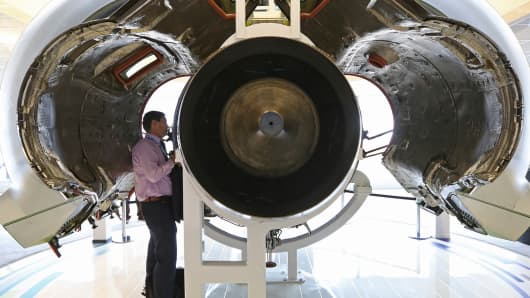 A visitor looks at a PurePower PW1500 aircraft engine manufactured by Pratt & Whitney, a unit of United Technologies Corp., at the Paris Air Show.