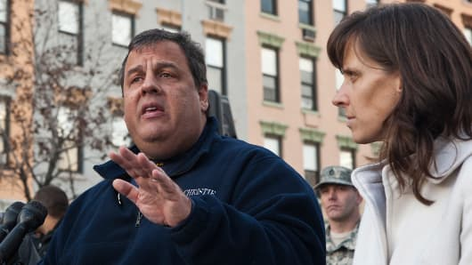 New Jersey Governor Chris Christie and Mayor Dawn Zimmer of Hoboken at a press conference after Hurricane Sandy.