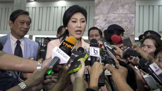 Thai caretaker Prime Minister Yingluck Shinawatra speaks to the media after a meeting with her cabinet amid continuing anti-government protests in Bangkok January 21, 2014.