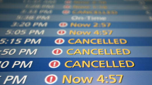 A departure board at Boston's Logan airport.