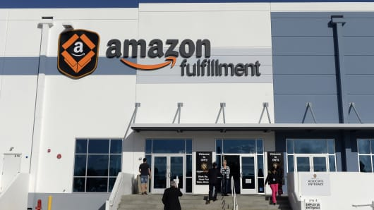 Employees arrive at Amazon warehouse in San Bernardino, Calif.