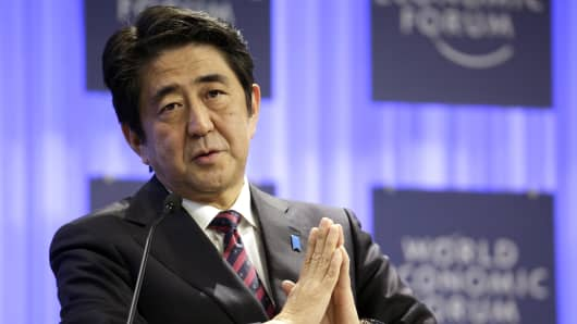 Shinzo Abe, Japan's prime minister, gestures during a session on the opening day of the World Economic Forum (WEF) in Davos, Switzerland, on Wednesday, Jan. 22, 2014