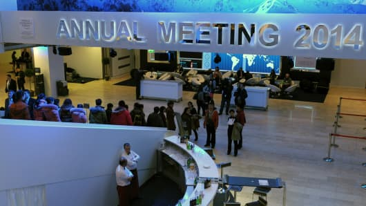 Participants arrive at the congress centere prior to the opening of the World Economic Forum in Davos on January 21, 2014.