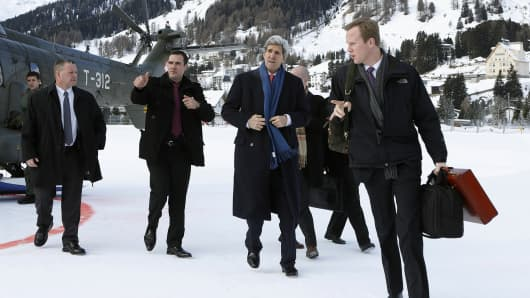 U.S. Secretary of State John Kerry (C) arrives in Davos, on January 23, 2014, to attend the World Economic Forum annual meeting in the Swiss Alps.