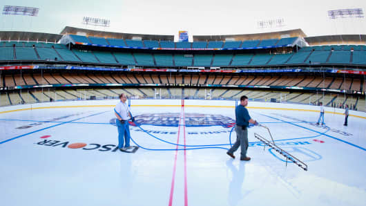 The ice crew works the rink as they prepare for the 2014 Coors Light NHL Stadium Series at Dodger Stadium in Los Angeles.