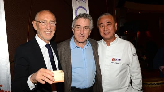 Meir Teper, actor Robert De Niro and chef Nobu Matsuhisa attend a sake ceremony during the grand opening celebration of the world's first Nobu Hotel Restaurant and Lounge Caesars Palace on April 28, 2013 in Las Vegas, Nevada.